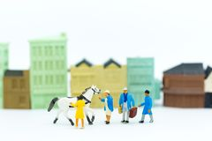 Miniature people : Pet market for animal lovers. Image use for business concept.  Stock Photo