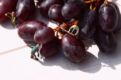 Miniature people picking red grapes B Stock Photo