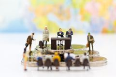Miniature people: Recruiter interview applicants. Image use for background Choice of the best suited employee, Royalty Free Stock Images