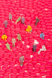 Miniature people with red pill Stock Image