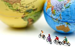 Miniature people : riding bicycle with world map,Sport, Travel a. Nd business concept Stock Photography