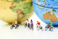 Miniature people : riding bicycle with world map,Sport, Travel a. Nd business concept Royalty Free Stock Photography