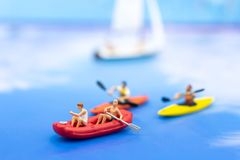 Miniature people, Rowing boat in the ocean. Image use for sports concept.  Stock Images