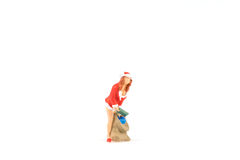 Miniature people Sandy Claus on background with space for text. Miniature people Sandy Claus on white background with space for text Stock Images
