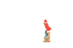 Miniature people Sandy Claus on background with space for text. Miniature people Sandy Claus on white background with space for text Royalty Free Stock Images