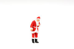 Miniature people Santa Claus on background with space for text Stock Photography
