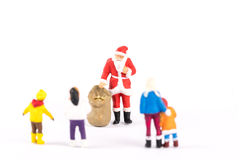 Miniature people Santa Claus on background with space for text Royalty Free Stock Photo