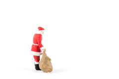 Miniature people Santa Claus on background with space for text Royalty Free Stock Image