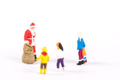 Miniature people Santa Claus on background with space for text Stock Photos