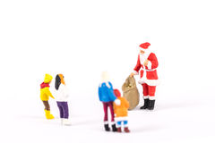 Miniature people Santa Claus on background with space for text Royalty Free Stock Photography
