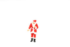 Miniature people Santa Claus on background with space for text. Miniature people Santa Claus on white background with space for text Royalty Free Stock Images