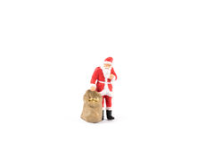 Miniature people Santa Claus on background with space for text. Miniature people Santa Claus on white background with space for text Royalty Free Stock Image