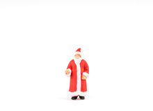 Miniature people Santa Claus on background with space for text. Miniature people Santa Claus on white background with space for text Royalty Free Stock Photos