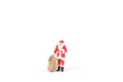 Miniature people Santa Claus on background with space for text. Miniature people Santa Claus on white background with space for text Royalty Free Stock Photo