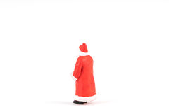 Miniature people Santa Claus on background with space for text. Miniature people Santa Claus on white background with space for text Stock Photo