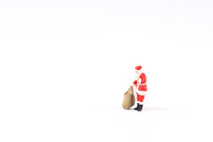 Miniature people Santa Claus on background with space for text Stock Photo