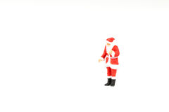 Miniature people Santa Claus on background with space for text. Miniature people Santa Claus on white background with space for text Royalty Free Stock Photography