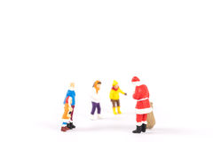 Miniature people Santa Claus on background with space for text. Miniature people Santa Claus on white background with space for text Stock Image