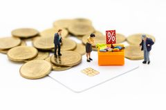 Miniature people:Shoppers with cash and credit or cashless. Image use for retail business, marketing concept.  Royalty Free Stock Images