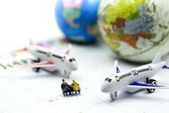 Miniature people : sitting with airplane,for travel around the world concept.  stock images