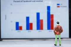 Miniature people : small figures businessmen stand and look at t royalty free stock images
