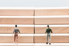 Miniature people :small figures businessmen walk up stair woode Stock Photo