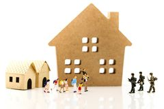 Miniature people : Soldier go home after mission complete with c. Hildren and family,coming home concept stock image