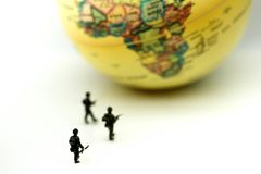 Miniature people : soldiers team with world map,War, army, milit. Ary, guard concept Stock Photos