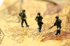 Miniature people : soldiers team with world map,War, army, milit. Ary, guard concept Stock Photo