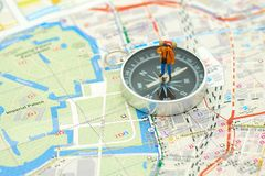 Miniature people standing travel planner on a compass with Japan map using as background travel concept with copy spaces and whit. E space for your stock photo