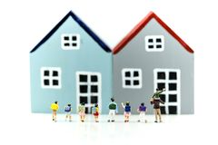 Miniature people : student and children with house,Education con. Cept royalty free stock image