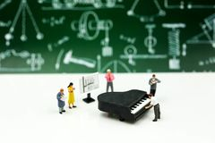 Miniature people : Teacher and student with piano class of music stock photos