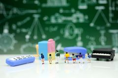 Miniature people : Teacher and students , children with School s. Upplies and piano , Back to school concept stock images
