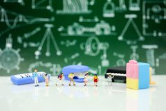 Miniature people : Teacher and students , children with School s. Upplies and piano , Back to school concept stock image