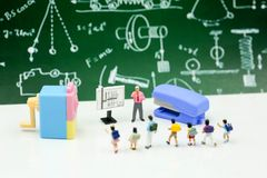Miniature people : Teacher and students , children with School s. Upplies and piano , Back to school concept royalty free stock photography