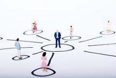 Miniature people on team Royalty Free Stock Image
