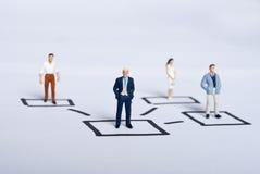 Miniature people on team stock images