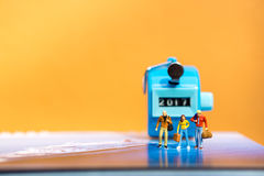 Miniature people teamwork on journey Royalty Free Stock Images
