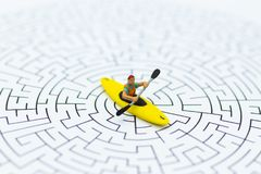 Miniature people: tourist boating, kayaking on the maze. Image use for Adventure, activity, travel concept.  stock photos