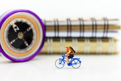 Miniature people: Tourists cycling . Image use for music of travel, business concept Royalty Free Stock Photography