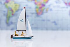Miniature people: Tourists with sports sailing. Image use for travel business concept.  Royalty Free Stock Images