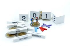 Miniature people travel with wooden of tax and 2018,Business and Stock Photos