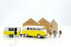 Miniature people: travelers with backpack standing on world map travel by van. Image use for travel business concept stock photos