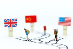 Miniature people: Travelers go to the oversea. Image use for traveling abroad, business concept.  Stock Photos