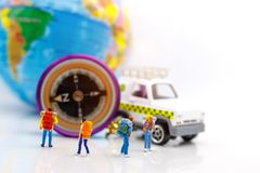 Miniature people: Traveller standing with globe and compass. Con royalty free stock photos