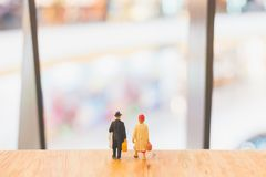 Miniature people : Travellers walking on The bridge. Holiday and Travel concept Stock Images