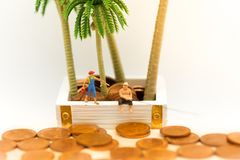 Miniature people: People use the fishing rod to take money from the floor. Image use for Hacking strategy business Royalty Free Stock Photo