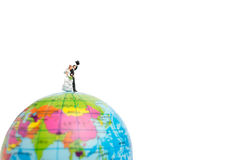 Miniature people wedding , bride and groom couple on The globe Royalty Free Stock Photography