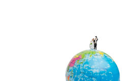 Miniature people wedding , bride and groom couple on The globe Royalty Free Stock Photos