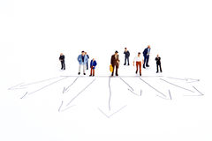 Miniature people on white with some diagrams Stock Photography